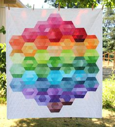 Hexie Harmony quilt made from Marcus Ombre 2 1/2 inch strips. Made by Janissa in our Pac Fab office. Quilted by the lovely Regina in our custom quilting department. Pattern is from Cut Loose Patterns.