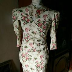 """VTG ALL THAT JAZZ ✂️ Floral Wrap Dress Elegant and sophisticated Vintage floral wrap puff sleeve dress from All That Jazz size 3/4. In excellent used condition. 50%Polyester / 50% Cotton. Flat lay measurements are  40' length/ 20' width armpit to armpit / 16' sleeve length / 13' waist / 17 1/2"""" hip. Please let me know if you have any additional questions before purchasing. Vintage Dresses"""