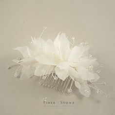The pure silk wedding flower comb is handmade with pure silk fabrics, Swarovski crystals and tarnish resistant silver plated wires. The pure silk petals of the wedding flower com are hand cut, hand pressed and assembled one by one with millinery methods. The wedding headpiece pictured is ivory hair flowers, clear Swarovski crystals on tarnish resistant silver plated wire. The tarnish resistant silver plated wire is a high quality wire and wont lose its color easily when its exposed to the…