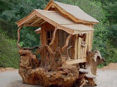 AMAZING~ a small house mad from a tree stump Fairy Houses, Dog Houses, Play Houses, Fairytale Cottage, Cliff House, Natural Homes, Wooden Playhouse, Playhouse Ideas, Unusual Homes