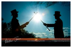 2 of the groomsmen with top hats and canes. Usher silouette. Basingstoke wedding photographer. Hampshire.