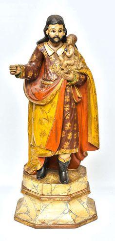 Imagem de São José dito de botas, entalhada em madeira, policroma e dourada. Minas Gerais, final do século XVIII.