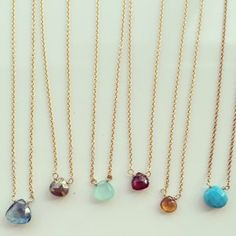 Dottie Necklace  - The Dottie necklaces are a beautiful classic that we introduced into our collection since the beginning of time. Tiny 4-6mm semi-precious gemstones float delicately within a 14kt gold filled chain. See added accent bead at clasp. These stones are available in a variety of colors including birthstones. Shown from L to R in the image are: london blue topaz, pyrite, chalcedony, garnet, citrine and turquoise. View dropdown menu for more options.