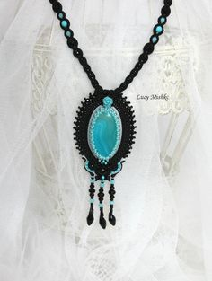 Light blue necklace - Light blue & black - large necklace - gift for her - Handmade soutache Jewelry - blue agate stone - blue rose Pendant is made in the art of embroidery soutache. The central element - Light blue agate Japanese glass beads. The colors - Black and Light blue  width - 5 sm (1/97 inches) height with Tassel- 12 sm (4/72 inches) length - 24 sm (9/25 inches)  Wrong Side of leather.  My handmade - 100%.  Welcome to my store: https://www.etsy.com/...