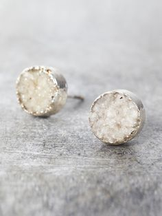 These raw crystal earrings are cut from slices of geodes, and then dipped in precious metal. Each pair is unique to nature, and truly one-of-a-kind, varying in color and shape. Shown in White. Measure