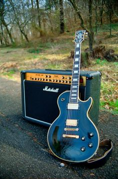 Ah....a Marshall amp. I would love to have that and that guitar...I think my hair just caught fire cause it's so beautiful!