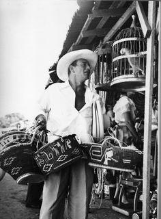 John Wayne shopping in Acapulco, 1959.