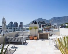 McKinnon House Unit 3 in Cape Town. Luxury 2 bedroom apartment in De Waterkant area with spectacular views over V&A Waterfront. Cape Town Accommodation, V&a Waterfront, Rooftop Deck, Table Mountain, Tree Line, The V&a, 2 Bedroom Apartment, Luxury Apartments, Modern Luxury