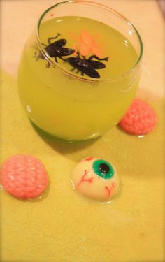 Zombie Barf - 16 Spooky Halloween Cocktails  1oz Midori Melon Liqueur    .5oz Vodka    Pineapple Juice    Pour all into a rocks glass filled with ice and stir, garnish with gummy brains and other various body parts. Find some HERE on Amazon.