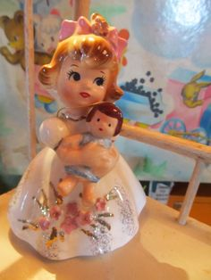 ~Vintage Birthday Figurine~    circa 1960s    Adorable Happy Birthday girl holding a baby. She has the original hang tag that has the  number 3