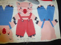 I can't believe someone had these for sale in 2013.  I wish I had seen then.  My grandmother made us girls a pig each.  I never knew my red pants pig was the one who built his house of staw.  Vintage 1940s 3 LITTLE PIGS  WOLF CUT  SEW FABRIC PANEL