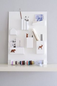 all white leaning wall organizer
