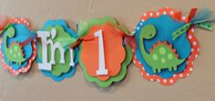 Dinosaur Lime Green, Turquoise Blue, and Orange Polka Dot I'm 1 High Chair Banner Highchair Baby Shower Dino Party Decorations. $16.00, via Etsy.