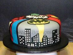 One layer cake. Easier to make and have each section be different super hero