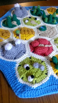 I just spent the last two weeks crocheting a Catan board as a birthday present for my friend. I've seen a lot of DIY Catan boards, but never a crocheted version that worked in the finer details of...