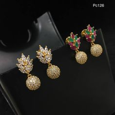 Beautiful ear studs with leaf design. Ear studs studded with white green and pink color stones and ball hanging.  20 September 2017.