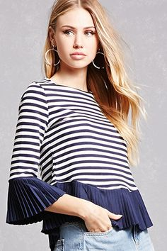 A crepe textured knit top in an oversized silhouette featuring short ruffle sleeves, a boxy cut, and an exposed back zipper.<p>- This is an independent brand and not a Forever 21 branded item.</p><p>- This item runs large, please size down.</p>