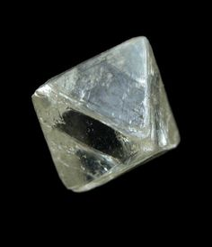 natural diamond shape is an octahedron. I've seen a couple of rings made with these. DeBeers has a whole collection.