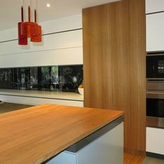 Cantilever K2 kitchen featuring a distinctive art-inspired splashback | cantileverinteriors.com