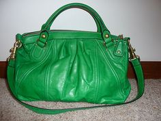 OMG!!!  I so need this bag asap!!!  Who wants to get it for me?  Juicy Couture Green Satchel bag