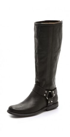 PHILLIP HARNESS BOOTS $66.07 An antiqued harness lends a western-inspired feel to a pair of leather Frye boots. Rubbed spots soften the heel and toe, and an exposed zip closes the back. Stacked heel and leather sole.