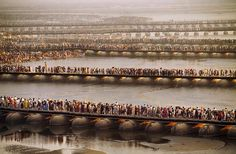 Steve McCurry - Photojournalist; Crowds waiting to bathe in the Ganges during Kumbh Mela Festival. 2011 (Photo: Steve McCurry) READ MORE: Unbelievable Photo of Millions of People Waiting