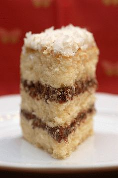 mounds bar cake is moist, tender, and soft buttery coconut cream cake with melted mounds marshmallow filling, and a butter-coconut flavored whipped cream frosting