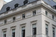 The design is neo-Georgian, the entire building is clad in a bright limestone with a beautiful mansard roof.