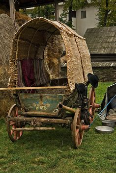 Caravan Gypsy Vardo Wagon:  A #Gypsy wagon with wood wheels and straw cover.