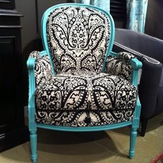 This beautiful black & white damask print comes alive & a conversation piece or the dream accent piece is created when the woodwork trim was painted this bright turquoise.  The element of surprise but still very classic.