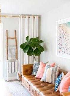 Cool California style beach cottage decor living room idea... great large beach art above the sofa.