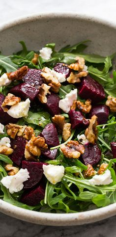 Easy, healthy, Arugula Salad with Beets, Goat Cheese, and Walnuts. With a simple lemon vinaigrette. Perfect combo!