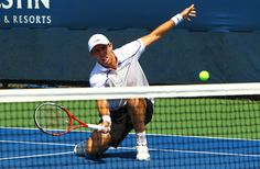Paul Hanley of Australia plays a forehand next to his partner Eric Butorac of United States during their men's doubles first round match against Jan Hajek of Czech Republic and Lukas Lacko of Slovakia on Day Two of the 2012 US Open