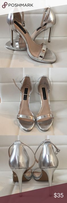 Steve Madden Rykie Silver Heels Amazing condition! Only worn once! Silver | Size 8.5 Patent leather Steven sandals with a slim ankle strap and low platform.  Buckle closure.  Covered heel and man-made sole. Steve Madden Shoes Heels