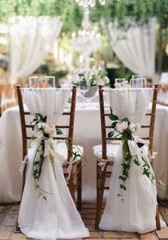 White fabric chair backs #wedding #chairbacks #decor