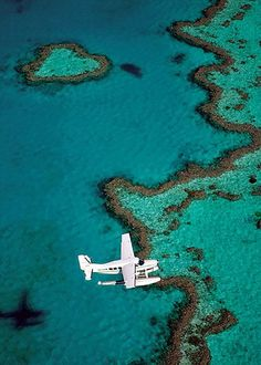Heart shaped coral island, Great Barrier Reef, Qld, Australia.