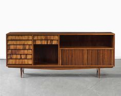 Credenza in caviona wood with drawers and tombor doors. By Carlo Hauner and Martin Eisler for Forma, Brazil, circa 1958.