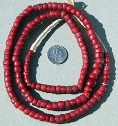 Trade Beads |  A strand of Venetian `whitehearts` made in Venice Italy and traded in West Africa in the 1800's.