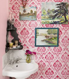 Mimic wallpaper on the cheap. A thirty dollar stencil from stencil-library.com yielded the pattern in the bathroom of this Oregon home. By choosing red paint, the deorator gave the old- fashioned damask modern zing. The landscape paintings are thrift-shop finds.