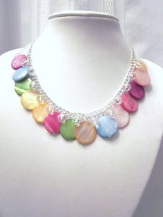 Rainbow Mother of Pearl Cluster Necklace --Accented with Clear Crystals - Chunky, Choker, Bib, Prom, Formals, Football and Fun. $25.50, via Etsy.