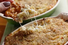 Skinny Artichoke Dip! Delicious hot artichoke dip baked with parmesan cheese, reduced fat mozzarella cheese and topped with bread crumbs...and low cal!