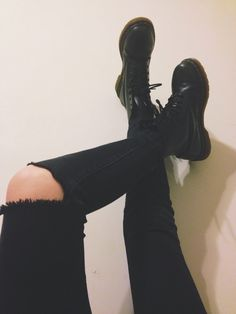 Ripped black skinny jeans with black lace-up Doc Marten style boots.....simplicity of this is INSPIRATIONAL!!! LOVE LOVE!!!