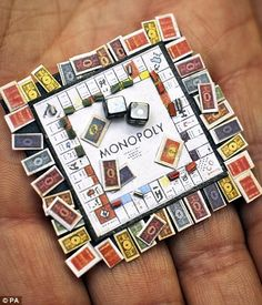 A miniature Monopoly board complete with houses, cards and money, made by Klaas Schultz of South Africa