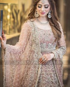 Buy Leading Designer Suits online perfect for Weddings and traditional occasions. Choose from our wide collection of Leading Designer Suits and ace the luxurious look at any party at affordable prices. Pakistani Engagement Dresses, Engagement Dress For Bride, Pakistani Dresses Casual, Pakistani Wedding Outfits, Pakistani Dress Design, Pakistani Gowns, Pakistani Couture, Pakistani Bridal Hairstyles, Pakistani Bridal Makeup