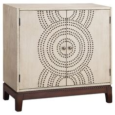 Adorned with bold nailheads, this hand-painted chest pairs artisan elegance with exotic verve.     Product: CabinetCon...