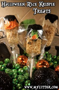 Halloween Rice Krispie Treats http://mylitter.com/recipes/halloween-rice-krispie-treas-on-a-stick-recipe/