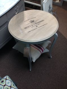 Moet table to sit with 2 rattan armchairs by radiator & window.
