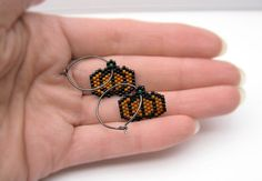 ♥ Harvest Pumpkin Earrings ♥   °º FREE SHIPPING WORLDWIDE º°   M A T E R I A L S Black .925s sterling silver hoop earrings (oxidized) Dark Orange, Green and Black delica glass beads Nymo nylon Threads  also available in 24k gold plated sterling silver hoops  S I Z E Apx. total length: 30mm. (1.2)  C A R E Keep away from strong perfumes or other corrosive liquids. Keep away from water…