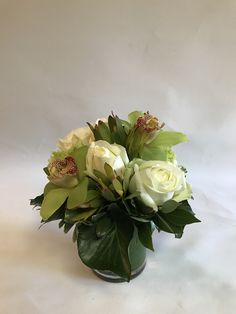 Deluxe Desk or Bedside Table Floral with roses, hydrangeas, cymbidium orchids and leucadendron.
