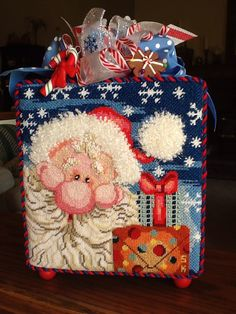 Sarah K. Stitched this super cute Santa finished as a boxed stand up. This is my kind of fun.